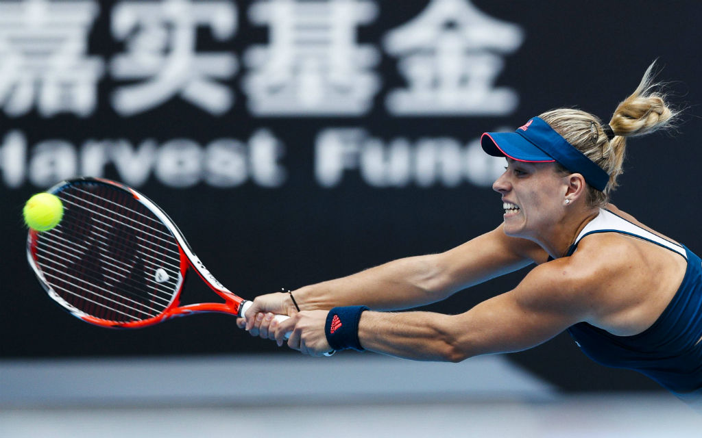 BEIJING, CHINA - OCTOBER 03: Angelique Kerber of Germany returns a shot against Katerina Siniakova of the Czech Republic during the Women\ s singles first round match on day three of the 2016 China Open at the China National Tennis Centre on October 3, 2016 in Beijing, China. Beijing China October 03 Angelique Kerber of Germany Returns A Shot Against Katerina Siniakova of The Czech Republic during The Women s Singles First Round Match ON Day Three of The 2016 China Open AT The China National Tennis Centre ON October 3 2016 in Beijing China