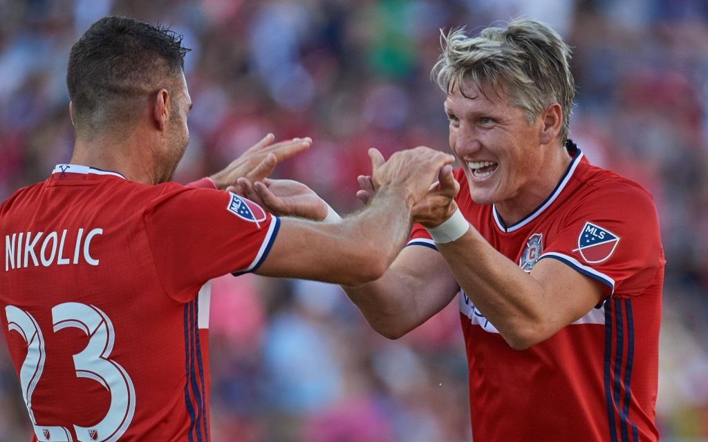Bastian Schweinsteiger und Nemanja Nikolic freuen sich über ein Tor gegen Vancouver.