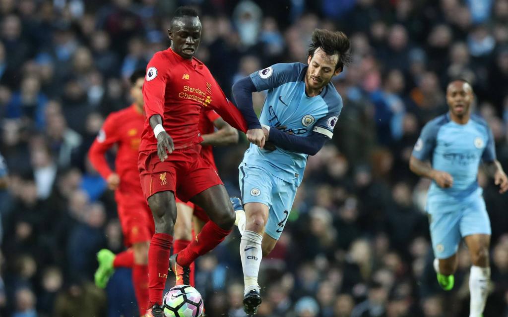 Imago/Sportimage: Liverpools Mane (l.) und Citys Silva (r.) werden sich auch am Samstag nichts schenken.