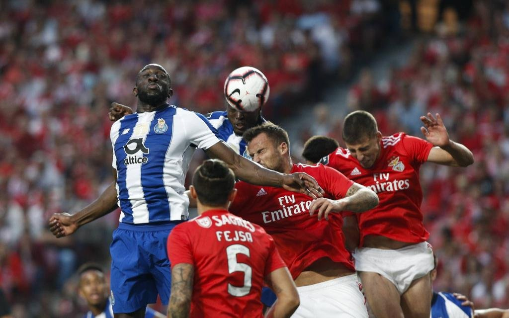 October 7, 2018 - Lisbon, Portugal - Moussa Marega of Porto (L) heads for the ball with during the Portuguese League football match between SL Benfica and FC Porto at Luz Stadium in Lisbon