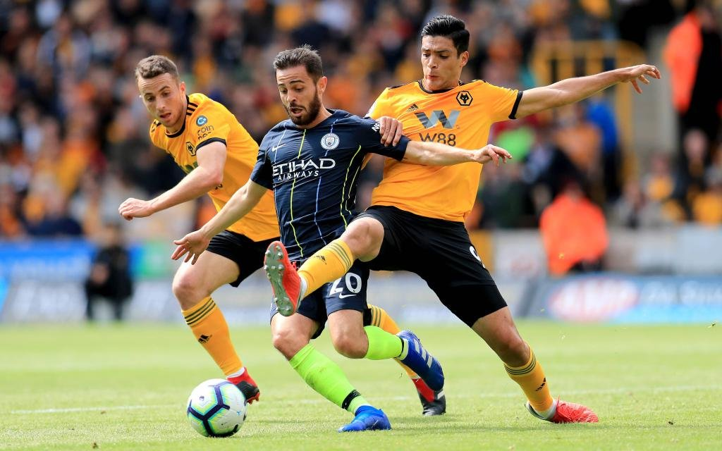 Wolverhampton Wanderers v Manchester City - Premier League - Molineux Manchester City s Bernardo Silva (centre) and Wolverhampton Wanderers Raul Jimenez battle for the ball