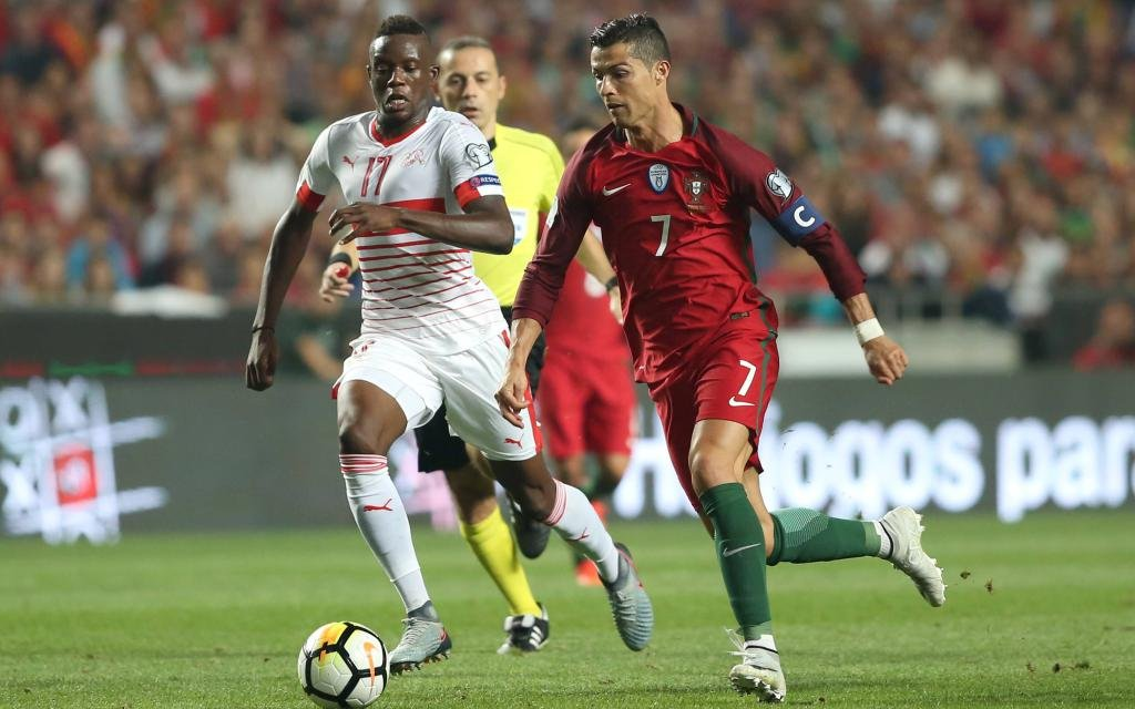 October 10, 2017 - Lisbon, Portugal - Portugal s forward Cristiano Ronaldo (L) vies with Switzerland s midfielder Denis Zakaria during the 2018 FIFA World Cup WM Weltmeisterschaft Fussball qualifying football match