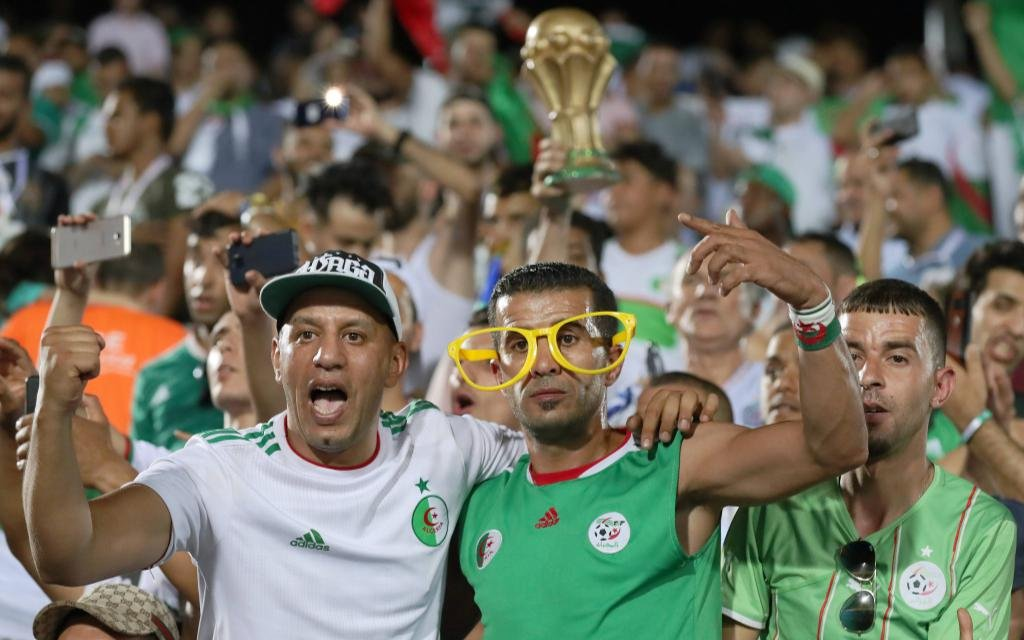 Supporters of the Algeria cheer up the team before the quarterfinal match between Cote d Ivoire and Algeria at the 2019 Africa Cup of Nations in Suez