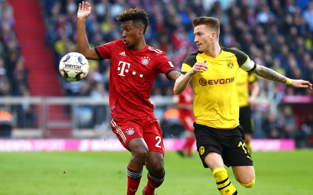 Samstag 06.04.2019, Saison 2018/2019, 1. Bundesliga, 28. Spieltag in der Allianz-Arena, FC Bayern München - BVB 09 Borussia Dortmund, Kingsley Coman (FCB) gegen Marco Reus (BVB)