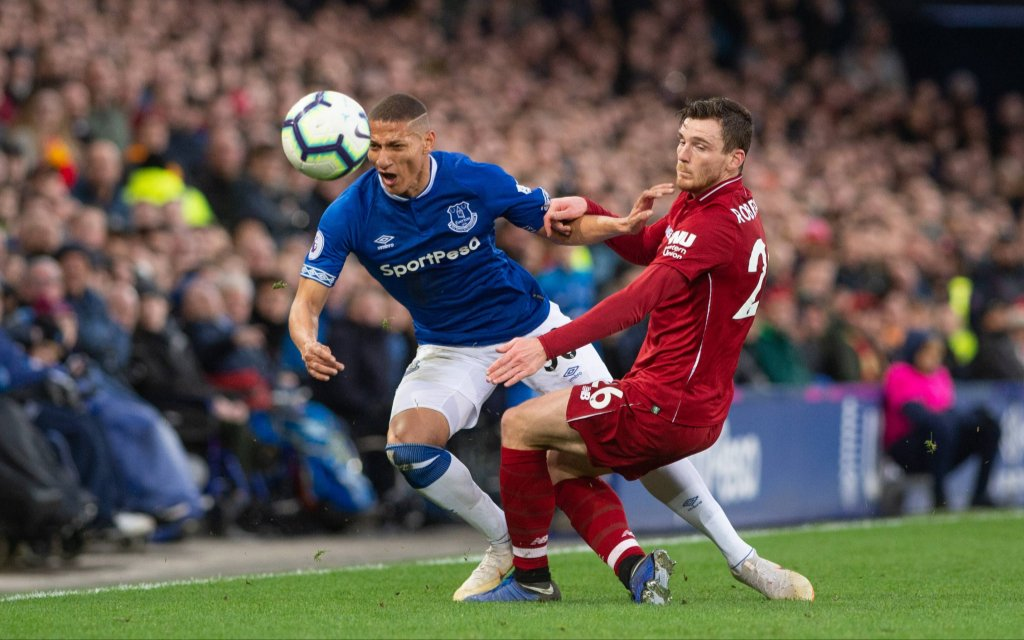 Liverpool, United Kingdom - LIVERPOOL, UK 3RD MARCH - Richarlison of Everton FC is challenged by Andy Robertson of Liverpool during the Premier League match between Everton and Liverpool at Goodison Park