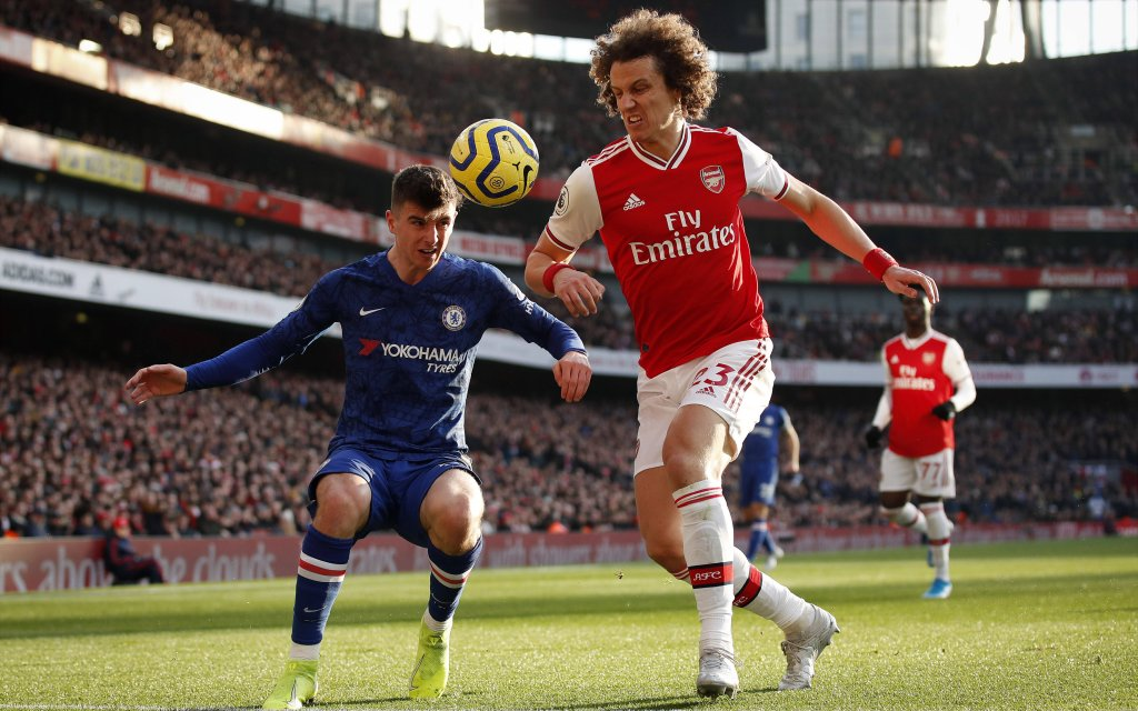 Arsenal s David Luiz tussles with Chelsea s Mason Mount during the Premier League match at the Emirates Stadium