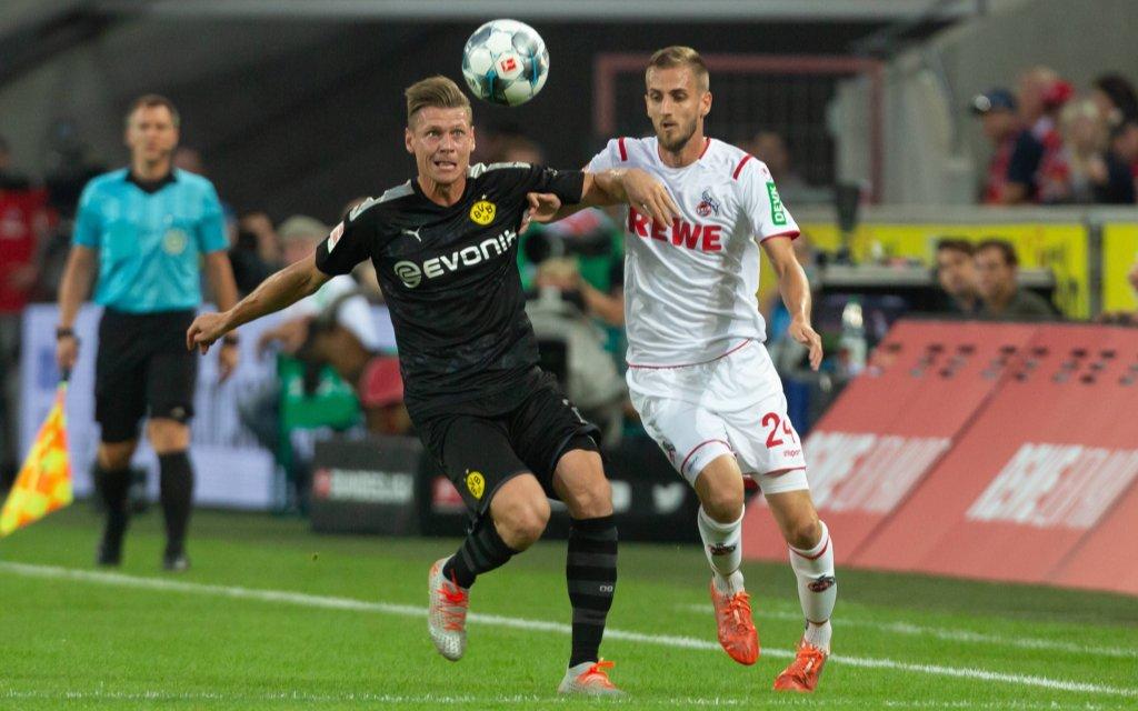 Koeln, Deutschland, 23.08.2019, 1. Bundesliga 2. Spieltag, 1. FC Koeln - Borussia Dortmund, Lukasz Piszczek (Dortmund, L) und Dominick Drexler (Koeln).