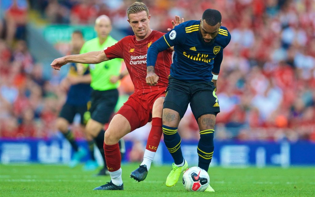 (190825) -- LIVERPOOL, Aug. 25, 2019 -- Liverpool s captain Jordan Henderson (L) challenges Arsenal s Alexandre Lacazette during the English Premier League match between Liverpool FC and Arsenal FC at Anfield in Liverpool