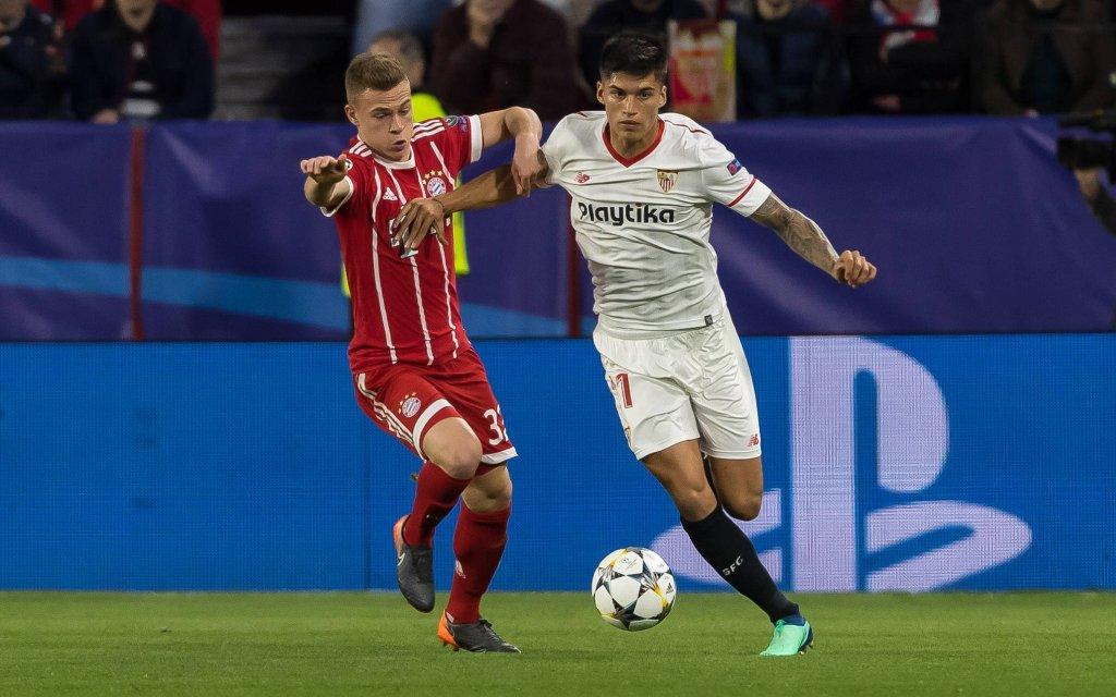 Spain, Sevilla 03.04.2018, UEFA Champions League - 2017/18 Season, Quarter-finals, First leg, Sevilla FC - FC Bayern Muenchen, Joshua Kimmich (FCB) und Joaquin Correa (FCS)