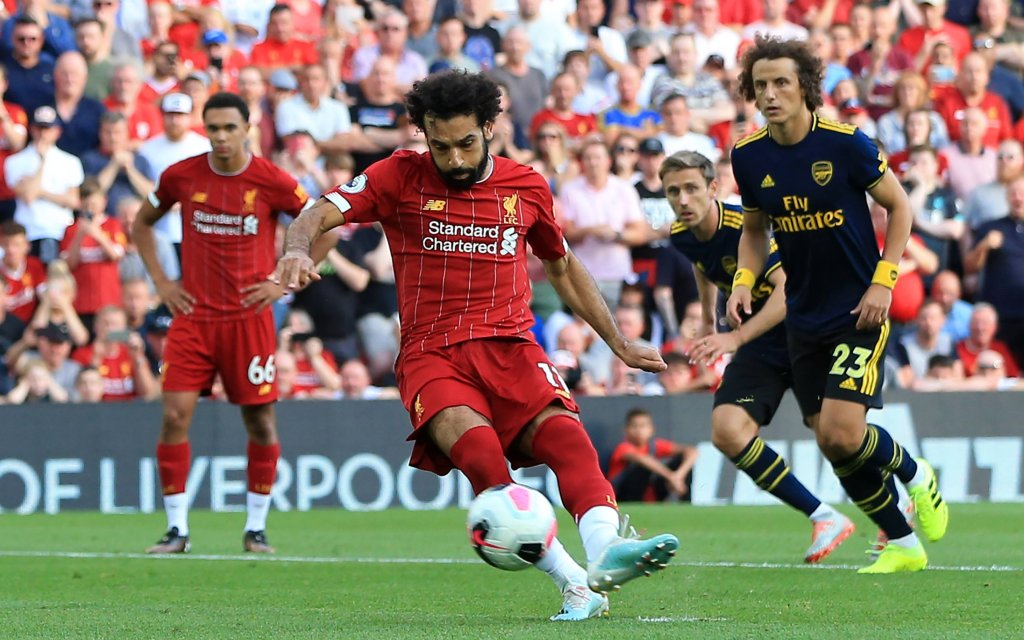 24th August 2019; Anfield, Liverpool, Merseyside, England; English Premier League Football, Liverpool versus Arsenal Football Club; Mohammed Salah of Liverpool beats Arsenal goalkeeper Bernd Leno from the penalty spot after 49 minutes to give his side a 2-0 lead