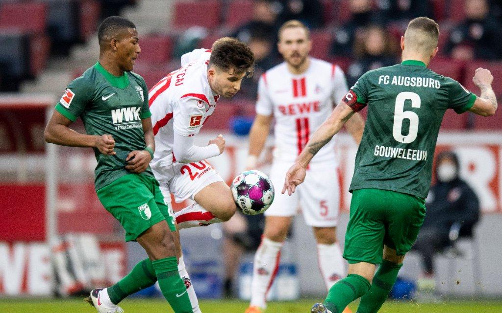 1.FC Köln - FC Augsburg Carlos Gruezo FCA, Elvis Rexhbecaj Köln, Jeffrey Gouweleeuw FCA 1.FC Köln - FC Augsburg 02.01.2021, Fussball, 1. Bundesliga, Saison 2020/21