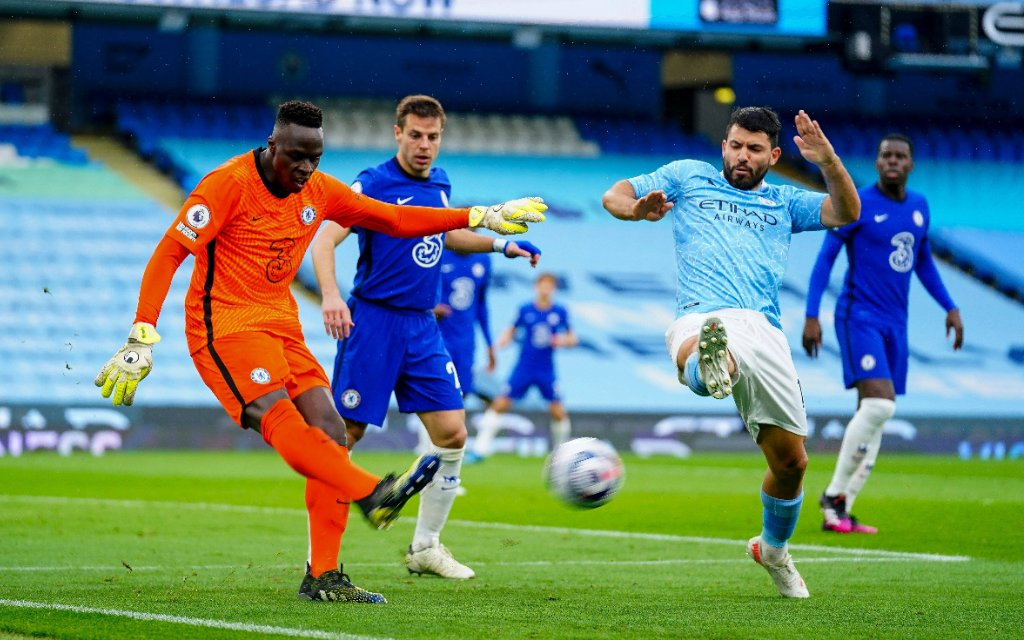 Goalkeeper Edouard Mendy of Chelsea clears the ball under pressure from Sergio Aguero of Manchester City Manchester City v Chelsea, Premier League, Football, The Etihad Stadium, Manchester, UK - 08 May 2021