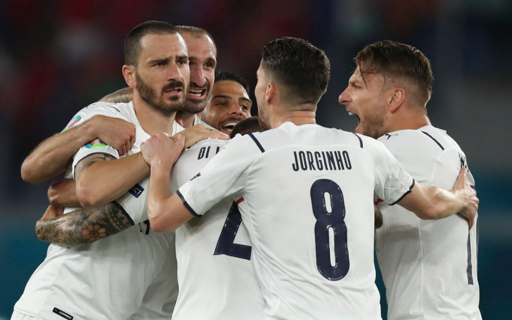 Players of Italy celebrate Turkey s defender Merih Demiral s owngoal during the group A match between Turkey and Italy at the UEFA EURO