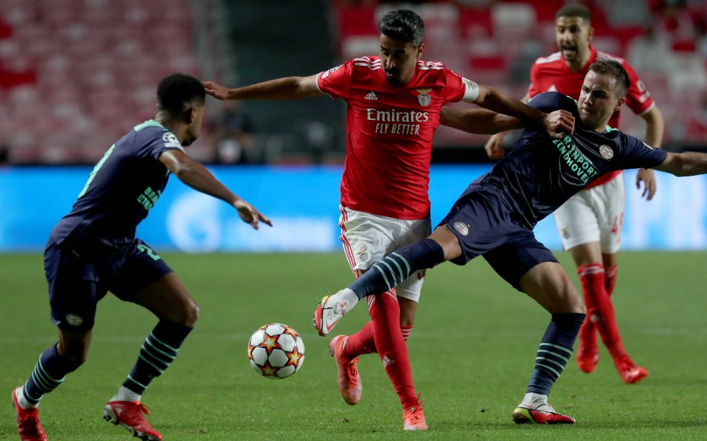 SL Benfica v PSV Eindhoven - UEFA Champions League Play-off Andre Almeida of SL Benfica C vies with Mario Gotze of PSV Eindhoven R during the UEFA Champions League play-off first leg football match between SL Benfica and PSV Eindhoven at the Luz stadium in Lisbo